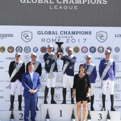 Harrie Smolders and Eric Lamaze of the Hamburg Diamonds are presented as the winners of the Global Champions League team event in Rome, Italy.