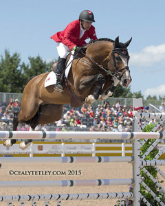Eric Lamaze and Coco Bongo, owned by Artisan Farms LLC, thrilled the home crowd by jumping clear.  Photo by Cealy Tetley