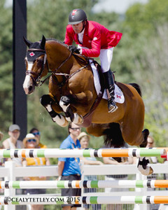 Eric Lamaze and Coco Bongo, owned by Artisan Farms LLC, thrilled the home crowd by jumping clear in the second round to secure Canada's 2016 Rio Olympic qualification.  Photo by Cealy Tetley