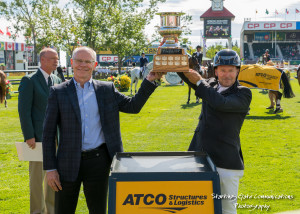 Eric Lamaze hoists the ATCO Structures & Logistics Cup trophy for the third time in his career at the Spruce Meadows 'Masters' Tournament. Photo by Starting Gate Communications