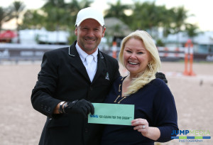 """Eric Lamaze receives his $3,000 bonus from SSG Gloves """"Go Clean for the Green"""" promotion manager Jennifer Ward.  Photo by Jump Media Photography"""