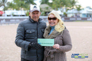 """Eric Lamaze receives his $3,000 bonus from SSG Gloves """"Go Clean for the Green"""" promotion manager Jennifer Ward. Photo by Jump Media"""