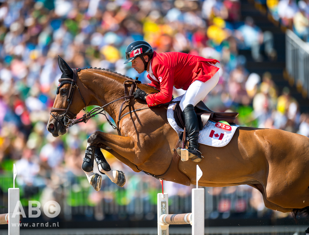 Eric Lamaze and Fine Lady 5, owned by Artisan Farms and Torrey Pines Stable, jumped another clear round to put them at the top of the individual leaderboard and lead Canada to fourth in the Team Final at the 2016 Olympic Games in Rio de Janeiro, Brazil. Photo by Arnd Bronkhorst Photography