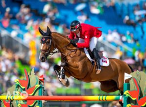 2008 Olympic Champion Eric Lamaze riding Fine Lady 5, owned by Artisan Farms and Torrey Pines Stable, jumped clear to secure Canada's place in the Team Final at the 2016 Olympic Games in Rio de Janeiro, Brazil. Photo by Arnd Bronkhorst Photography