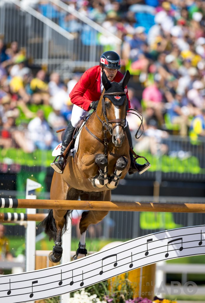 2008 Olympic Champion Eric Lamaze and Fine Lady 5, owned by Artisan Farms and Torrey Pines Stable, jumped clear for Canada on the opening day of show jumping competition at the 2016 Olympic Games held Sunday, August 14, in Rio de Janeiro, Brazil. Photo by Arnd Bronkhorst Photography