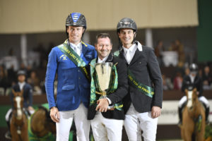 Eric Lamaze is presented as the winner of the Rolex IJRC Top Ten Final, joined on the podium by world number one Christian Ahlmann (left) of Germany and 2012 Olympic Champion Steve Guerdat of Switzerland. Photo by ROLEX/Kit Houghton