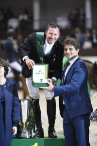 Eric Lamaze is presented with a Rolex watch in recognition of his victory by Arnaud Boetsch, Rolex SA Communication & Image Director.  Photo by ROLEX/Kit Houghton