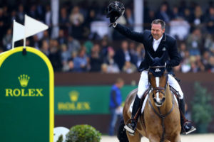 Eric Lamaze celebrates with the crowd after jumping two clear rounds in the fastest time riding his 2016 Olympic bronze medal partner, Fine Lady 5, owned by Artisan Farms.  Photo by Arnd Bronkhorst Photography